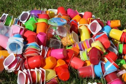 One brown planet, plastic cups, takeaway drinks, waste